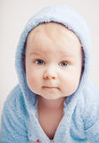 Small boy in blue overalls Stock Images