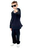 Small boy in blue suit pointing at you Royalty Free Stock Photography