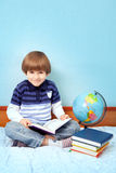 Small boy with book Royalty Free Stock Images