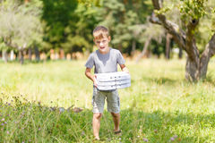 Small boy bringing three box of pizza for a picnic Stock Photography