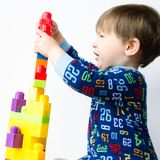 Small boy builds tower Stock Photos