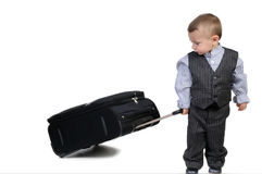 Small boy carrying a suitcase Royalty Free Stock Photo