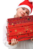 Small boy carrying three presents isolated Royalty Free Stock Photos