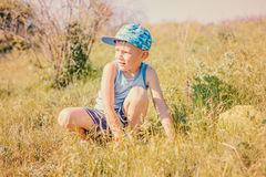 Small boy catching insects in summer Royalty Free Stock Image