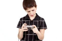 Small boy checking analog camera settings Royalty Free Stock Images