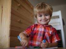 Small boy child drawing with colorful marker pen. stock photography