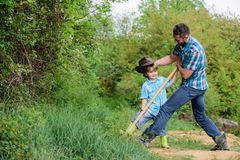 Small boy child help father in farming. new life. soils and fertilizers. rich natural soil. Eco farm. Ranch. father and. Son planting family tree. happy earth stock images
