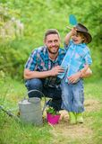 Small boy child help father in farming. watering can, pot and hoe. Garden equipment. father and son in cowboy hat on. Ranch. happy earth day. Family tree royalty free stock photography