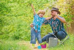 Free Small Boy Child Help Father In Farming. Happy Earth Day. Family Tree Nursering. Eco Farm. Watering Can, Pot And Hoe Stock Photo - 159036320