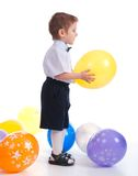 Small boy with colorful  air balloon. Royalty Free Stock Photo