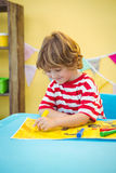 Small boy colouring in his picture Royalty Free Stock Photography