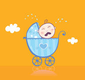 Small boy crying in pram Stock Image