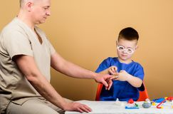 Small boy with dad in hospital. father and son in medical uniform. happy child with father with stethoscope. family. Doctor. medicine and health. hospital royalty free stock images