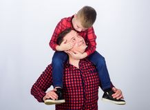 Small boy with dad man. fathers day. Enjoying time together. Happy family together. childhood. parenting. father and son. In red checkered shirt. Creating new stock photos