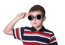 Small boy in dark glasses pretends to be a pilot Stock Photo