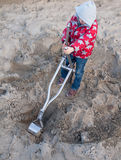 Small boy digging in a sand pit Royalty Free Stock Photos
