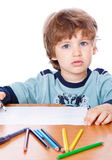 A small boy is drawing Royalty Free Stock Photography