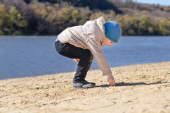 Small boy drawing in the beach sand Royalty Free Stock Photo