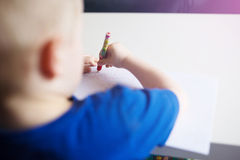 Small boy drawing a car Royalty Free Stock Photo