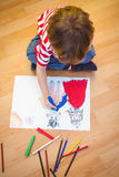 Small boy drawing on paper Royalty Free Stock Image
