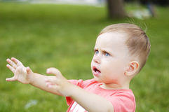 Small boy drawl. In outdoor Stock Image
