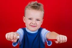 Small boy draws Stock Photo