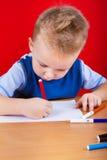 Small boy draws Stock Photography