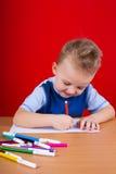 Small boy draws Stock Image