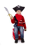 Small boy dressed like pirate holding toy sword Stock Images
