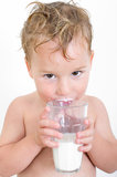 Small boy drinking milk Stock Photography