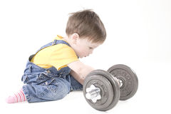 Small boy with dumbbell Stock Photo