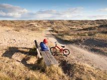 Small boy in dune landcsape Stock Photo