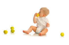 Small boy eating an apple Stock Photography