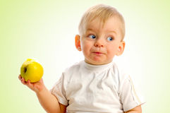 Small boy eating an apple Stock Image