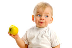 Small boy eating an apple Stock Images