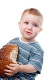 Small boy eating  a bread. Royalty Free Stock Image