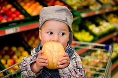 Small boy eating bread rolls Royalty Free Stock Photos