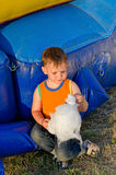 Small boy eating a portion of candy floss Stock Photo