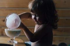 Small boy eating yoghurt Royalty Free Stock Photos