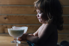 Small boy eating yoghurt Stock Photos