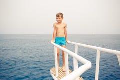 Small boy enjoying summer vacation on sea Stock Photos
