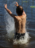 Small boy enjoying swim in a lake in Finland on a warm summer day in July heat. Royalty Free Stock Image