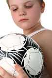 Small boy examining soccer ball isolated on white Stock Image