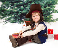 The small boy in fancy dress of pirate. Against xmas tree Royalty Free Stock Photos
