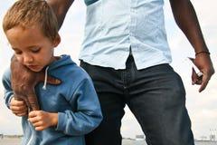 Small boy feeling safe Stock Photo