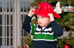 Small boy with fireman hat Royalty Free Stock Image