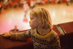 A small boy gazes down at some ballroom dancers Stock Photography