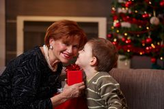 Small boy getting present from grandmother Stock Photography