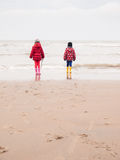 Small boy and girl on the beach Stock Images
