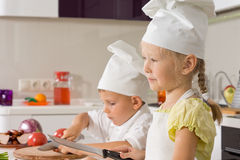 Small boy and girl cooking together in the kitchen Royalty Free Stock Photography
